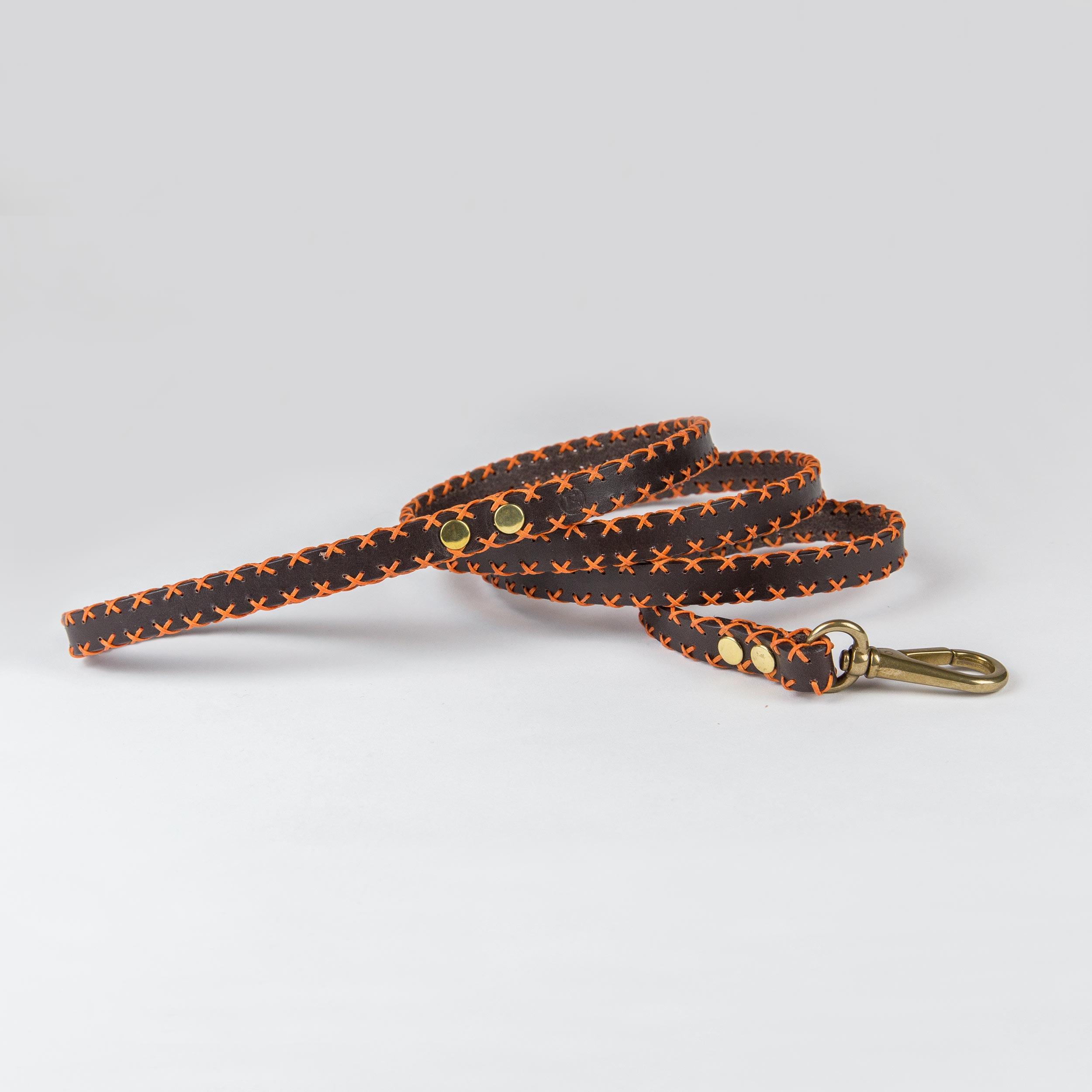 dark brown cowhide leather leash with orange weaves