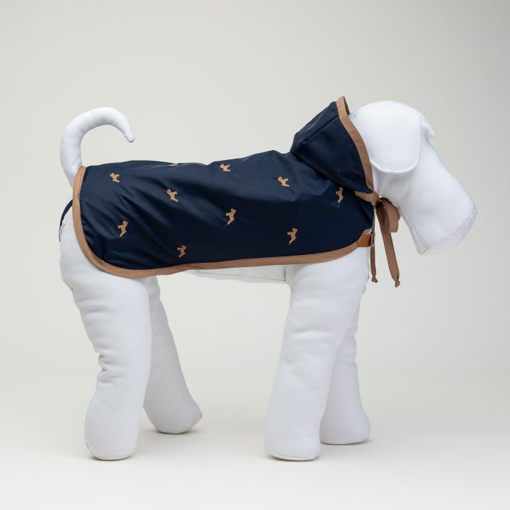 blue bespoke lined and embroidered raincoat for dogs